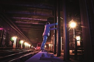 graffiti_artist_standing_on_wood_covering_of_3rd_rail